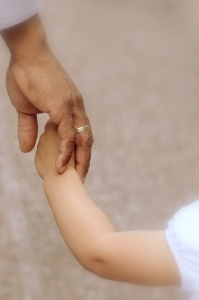 Kid and parent hand.jpg